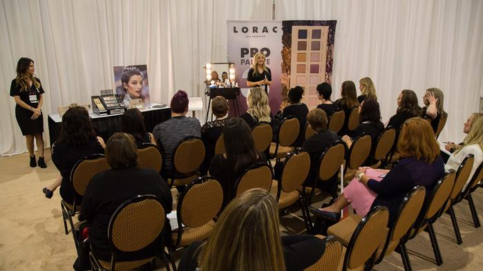 Kohl's beauty advisors attend a LORAC presentation.