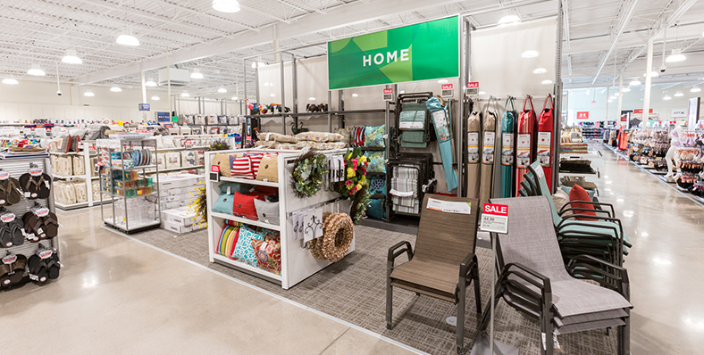 Clear signs and center department fixtures help customers navigate the store.